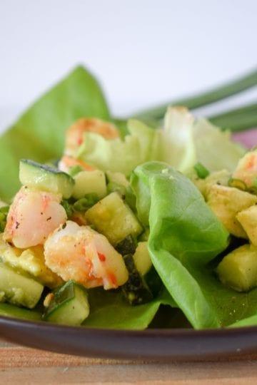 The shrimp lettuce wraps on a plate