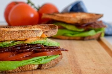 close up of a turkey blt with avocado
