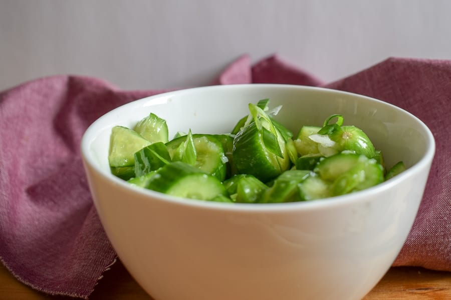 smashed cucumber salad in a bowl