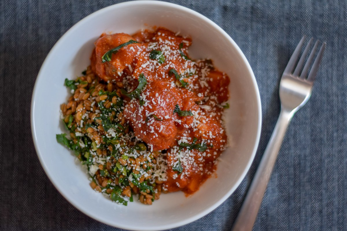 Overhead shot of meatballs and farro in a bowl