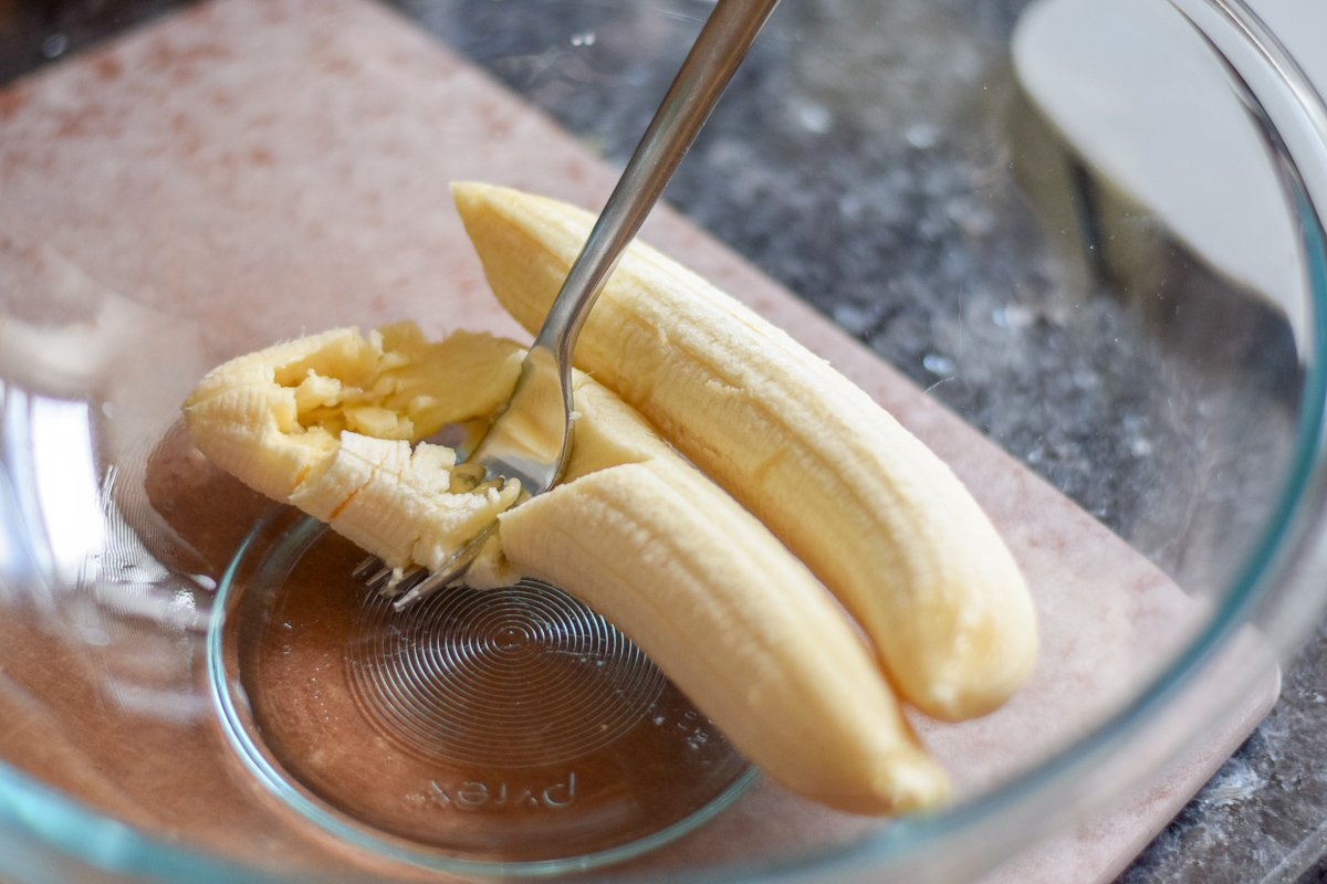 Bananas mashing in a bowl