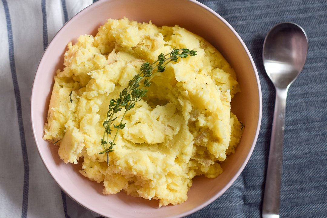 close up of garlic mashed potatoes in a bowl